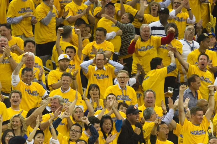 Warriors fans cheer a made basket by Draymond Green in the 4th quarter that brought the Warriors to within one point behind San Antonio in game 3 of the NBA Western Conference Semifinals between the Golden State Warriors and  the San Antonio Spurs at Oracle Arena, in Oakland, Calif. on May 10, 2013.