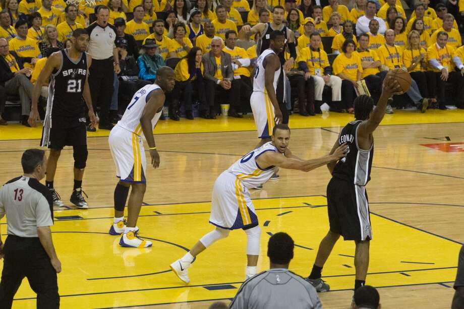 The Warriors (30) Stephen Curry fouls San Antonio's Kawhi Leonard after spraining his ankle in game 3 of the NBA Western Conference Semifinals between the Golden State Warriors and  the San Antonio Spurs at Oracle Arena, in Oakland, Calif. on May 10, 2013.