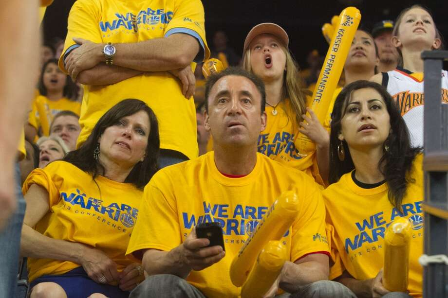 Warriors fans watch the action during the second half of game 3 of the NBA Western Conference Semifinals between the Golden State Warriors and  the San Antonio Spurs at Oracle Arena, in Oakland, Calif. on May 10, 2013.