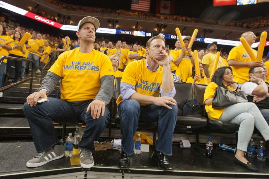 Golden State Warriors fans (left to right) Chester Aldridge and J.J. Davis, both of San Rafael, watch the last minutes of game 3 of the NBA Western Conference Semifinals against the San Antonio Spurs at Oracle Arena, in Oakland, Calif. on May 10, 2013.