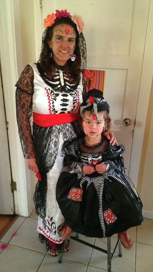 And this mother and daughter wear costumes.