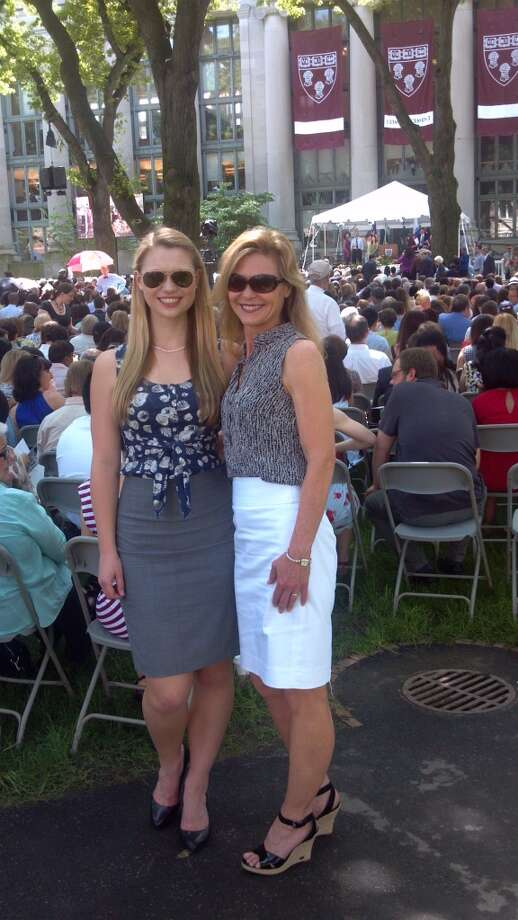 This mother is supporting her daughter as she graduates from Harvard. Photo: Lisa Valenzuela