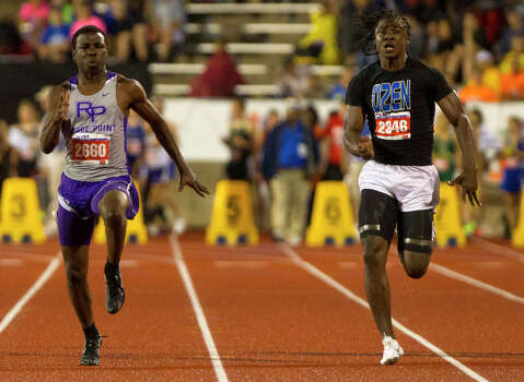 Fort Bend Ridge Points High School's Cameron Burrell, left, Beaumont Ozen's Tony Brown, right, during the 4A Boys 100 Meter Dash the state track meet at Mike A. Myers Stadium in Austin Friday, May 10, 2013, in Austin. Photo: Cody Duty, Houston Chronicle / © 2013 Houston Chronicle