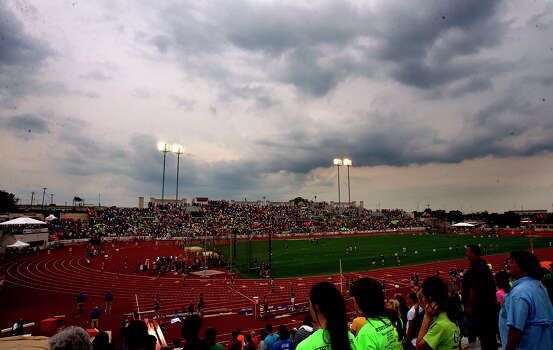 Rain clouds form over Mike A. Myers Stadium as the High School State Track meet takes place Friday, May 10, 2013, in Austin. The meet faced a rain delay as lightning moved into the area. Photo: Cody Duty, Houston Chronicle / © 2013 Houston Chronicle