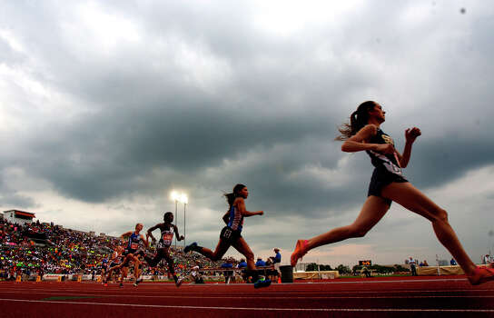 Rain clouds form over Mike A. Myers Stadium as the 4A Girls 800 Meter run takes place at the UIL High School State Track meet Friday, May 10, 2013, in Austin. The meet faced a rain delay as lightning moved into the area. Photo: Cody Duty, Houston Chronicle / © 2013 Houston Chronicle