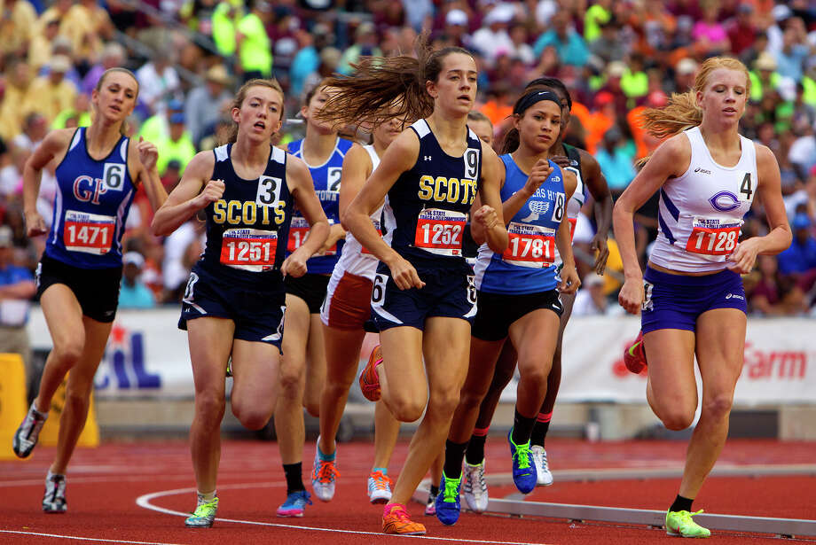 Girls make their way around the track during the 4A 800 meter run at the UIL High School State Track Meet at Mike A. Myers Stadium Friday, May 10, 2013, in Austin. Photo: Cody Duty, Houston Chronicle / © 2013 Houston Chronicle