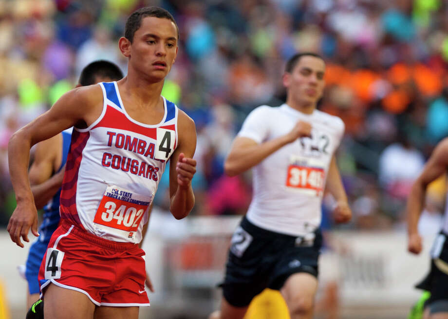 Tomball's Caleb Beacham, left, makes his way around the track during the 4A Boys 800 meter run at the UIL High School State Track Meet at Mike A. Myers Stadium Friday, May 10, 2013, in Austin. Photo: Cody Duty, Houston Chronicle / © 2013 Houston Chronicle