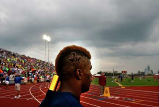 Wyatt High School's Javonte Adams has the state of Texas cut into his hair combined with and X and 1 symbolizing the 4x100 relay as he waits to enter the track for the event at the UIL High School State Track Meet at Mike A. Myers Stadium Friday, May 10, 2013, in Austin. Photo: Cody Duty, Houston Chronicle / © 2013 Houston Chronicle
