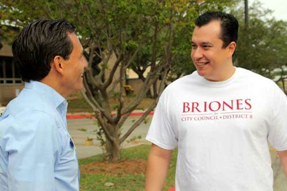 District 8 City Council Candidate Rolando Briones checks in with campaign supporter Roland Gonzales outside Hobby Middle School Saturday morning. Voter turnout was slow, even in District 8 where no incumbent is running. Photo/ John Tedesco