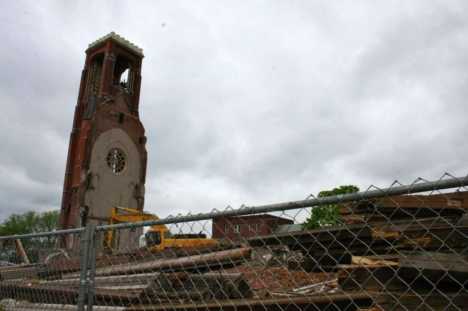 On Saturday, the tower of St. Patrick's Church still stood after it withstood attempts to bring it down on Thursday and Friday. (Kristen V. Brown/Times Union)