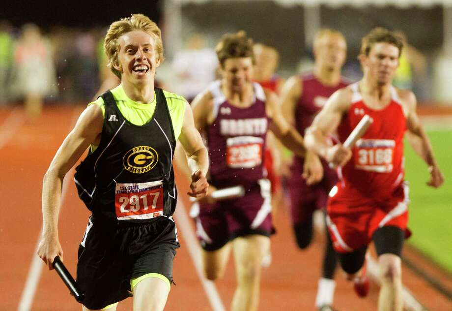 Grady High School's Brandon Lucas, left, smiles as he crosses the finish line winning the 1A Boys 4x400 Meter Relay during the UIL High School State Track Meet at Mike A. Myers Stadium Saturday, May 11, 2013, in Austin. Photo: Cody Duty, Houston Chronicle / © 2013 Houston Chronicle
