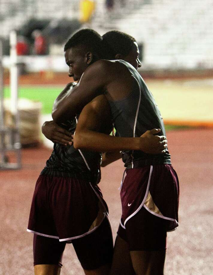 Humble Summer Creek's Xiaver Lightener, left, hugs Sydney Washington, right after winning the 4A Boys 4x400 Meter Relay during the UIL High School State Track Meet at Mike A. Myers Stadium Saturday, May 11, 2013, in Austin. Photo: Cody Duty, Houston Chronicle / © 2013 Houston Chronicle