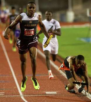 Lancaster High School's Eric Age, right, falls to the ground as Humble Summer Creek High School's Aaron Sharp crosses the finish line winning the 4A Boys 4x400 Meter Relay during the UIL High School State Track Meet at Mike A. Myers Stadium Saturday, May 11, 2013, in Austin. Photo: Cody Duty, Houston Chronicle / © 2013 Houston Chronicle
