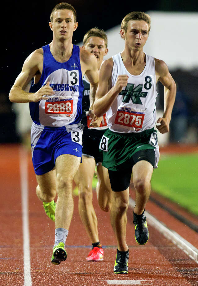 Houston Kingwood Park's Michael Lindberg, right, takes over the lead, as Friendswood's Ryan Teel, left, falls back during the 4A Boys 1600 Meter Run during the UIL High School State Track Meet at Mike A. Myers Stadium Friday, May 10, 2013, in Austin. Photo: Cody Duty, Houston Chronicle / © 2013 Houston Chronicle
