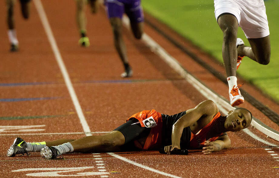Lancaster High School's Eric Age falls to the ground at the finish line during the 4A Boys 4x400 Meter Relay during the UIL High School State Track Meet at Mike A. Myers Stadium Saturday, May 11, 2013, in Austin. Photo: Cody Duty, Houston Chronicle / © 2013 Houston Chronicle