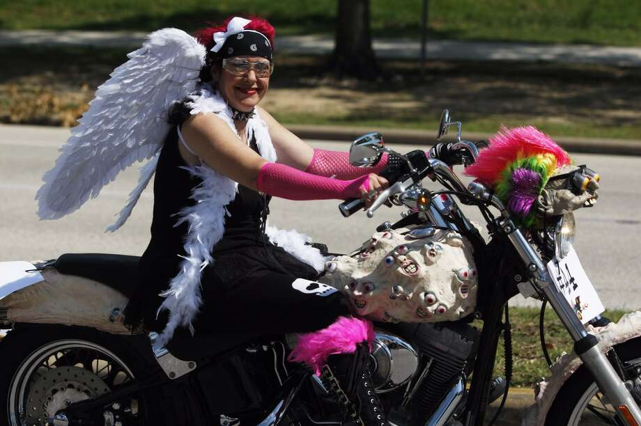 Kimberly Bainter riding at the Art Car Parade on Saturday. Photo: Johnny Hanson/Chronicle