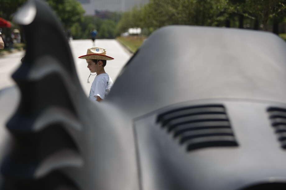 Alexandre Keyes, 5 of Houston checks out the Batmobile at theArt Car Parade on Saturday. Photo: Johnny Hanson/Chronicle