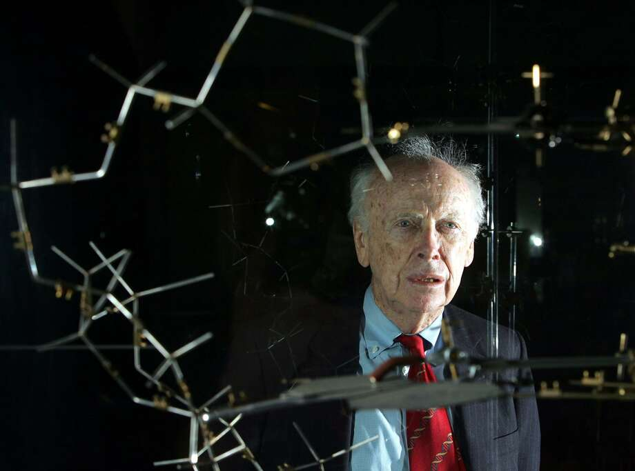 Geneticist James Watson poses with the original double helical DNA model in 2005 at the science museum in London. Photo: ODD ANDERSEN, Staff / AFP