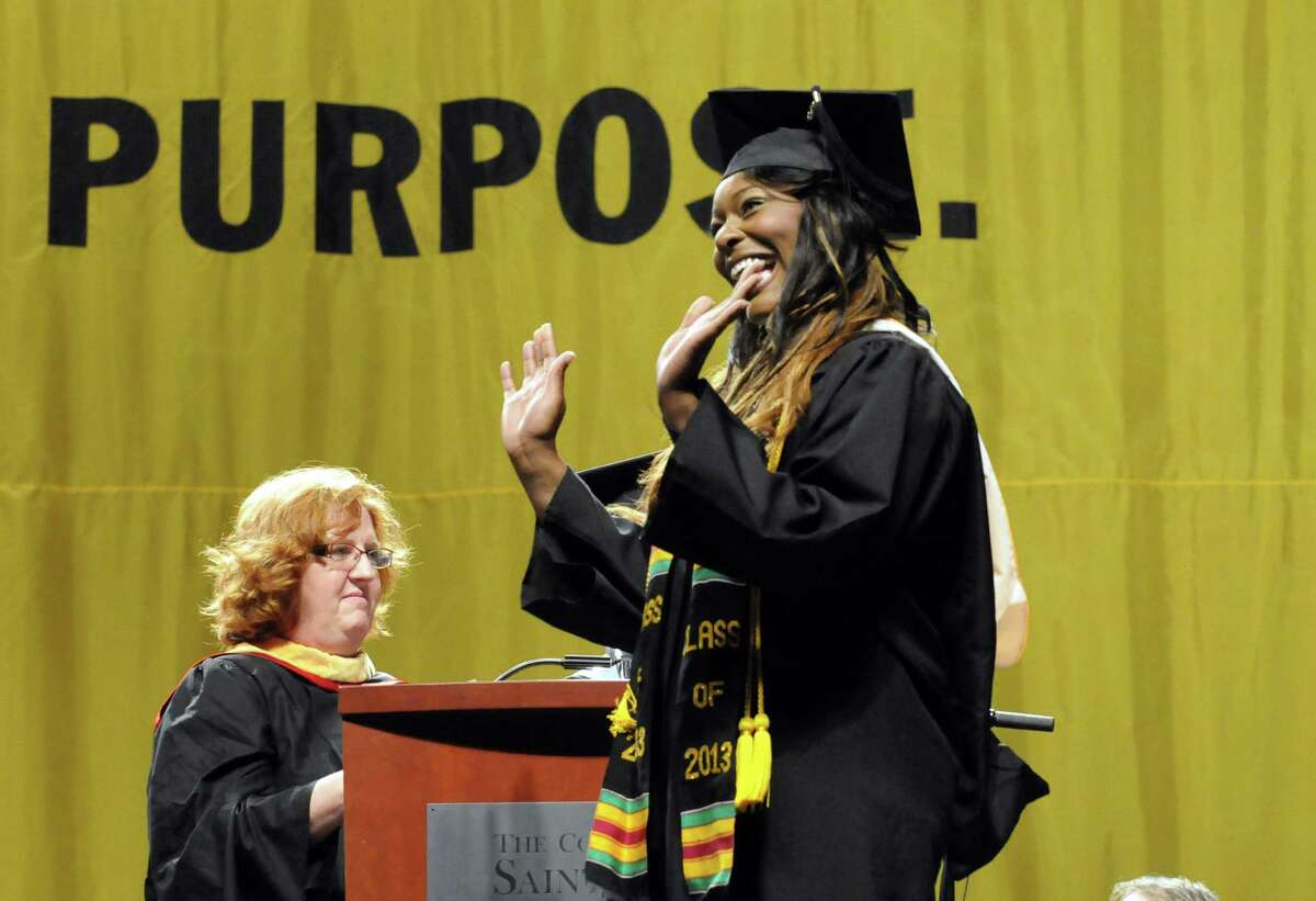 Graduate Raven Nicole Short waves to the audience as she walks the stage during The College of St. Rose 90th Annual Commencement at the Times Union Center on Saturday May 11, 2013 in Albany, N.Y. (Michael P. Farrell/Times Union)