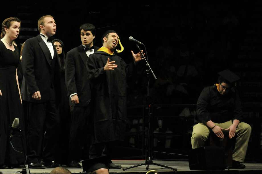 "Members of The College of St. Rose Chamber Choir perform ""Toward The Light""  during The College of St. Rose 90th Annual Commencement at the Times Union Center on Saturday May 11, 2013 in Albany, N.Y. (Michael P. Farrell/Times Union) Photo: Michael P. Farrell"