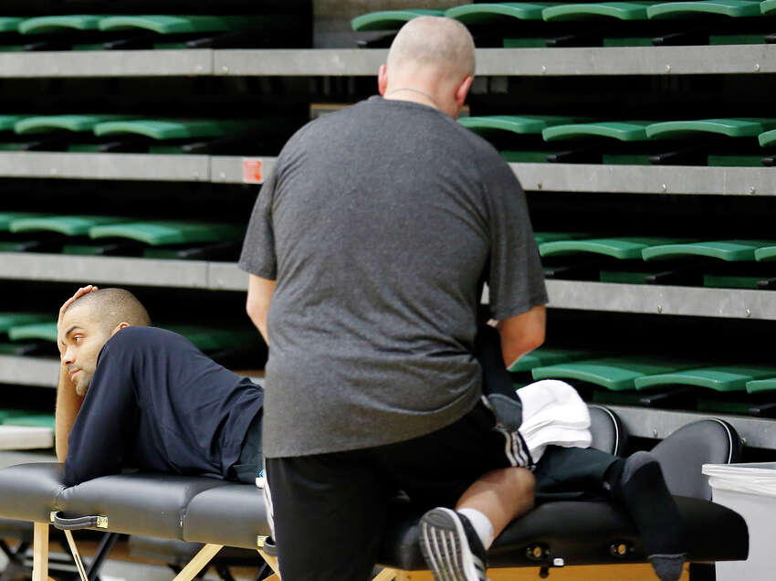 San Antonio Spurs' Tony Parker has his left leg worked on during practice Saturday May 11, 2013 at the War Memorial Gymnasium on the University of San Francisco campus in San Francisco, CA