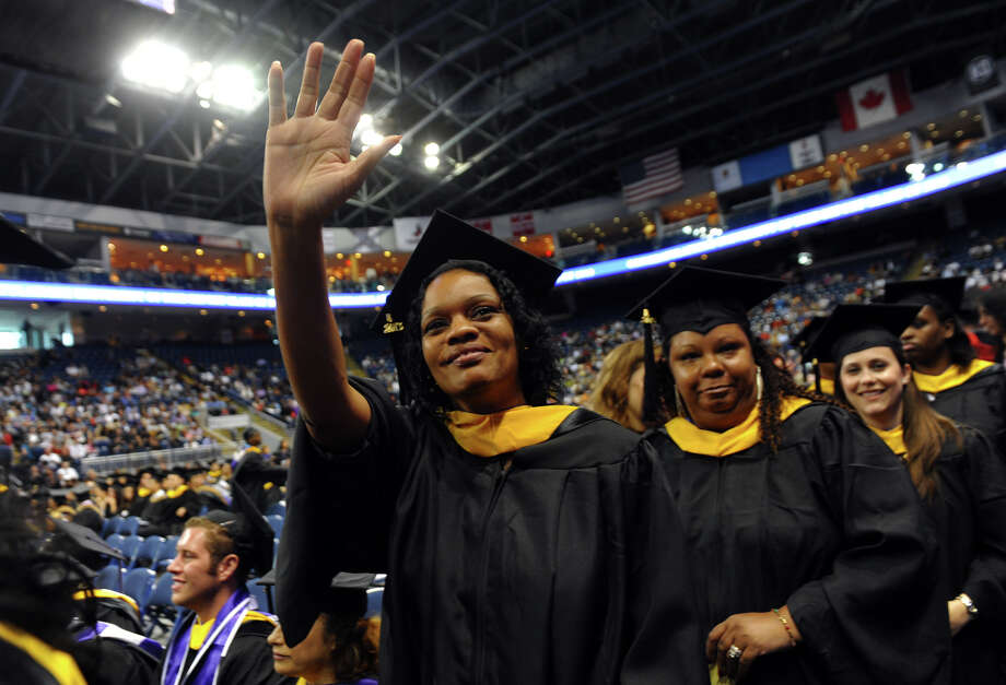 University of Bridgeport graduate Janelle Titus waves to family before getting her diploma, during the school's 103rd Commencement Ceremony held at the Webster Bank Arena in Bridgeport, Conn. on Saturday May 11, 2013. Photo: Christian Abraham / Connecticut Post