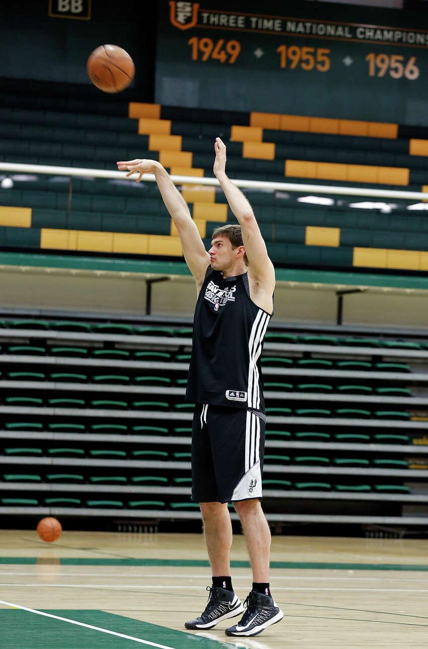 San Antonio Spurs' Tiago Splitter shoots during practice Saturday May 11, 2013 at the War Memorial Gymnasium on the University of San Francisco campus in San Francisco, CA
