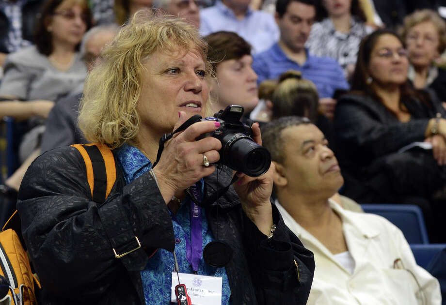 Mary-Jane Dubner, from University of Bridgeport's Ideal Program, takes pictures of students, during the school's 103rd Commencement Ceremony held at the Webster Bank Arena in Bridgeport, Conn. on Saturday May 11, 2013. Dubner is the Associate Dean of Admissions in the program, which is an accelerated adult program for people 23 and older who want to work on getting their degree. Photo: Christian Abraham / Connecticut Post