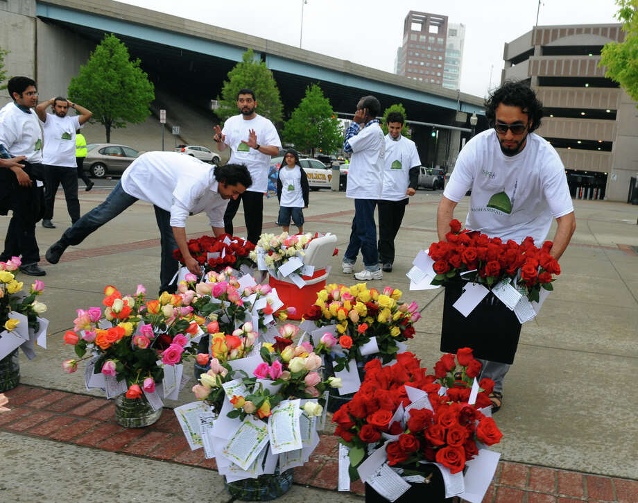 Members of University of Bridgeport's Saudi Student Club put out roses to be given out to graduates and families during the school's103rd Commencement Ceremony held at the Webster Bank Arena in Bridgeport, Conn. on Saturday May 11, 2013. Photo: Christian Abraham / Connecticut Post