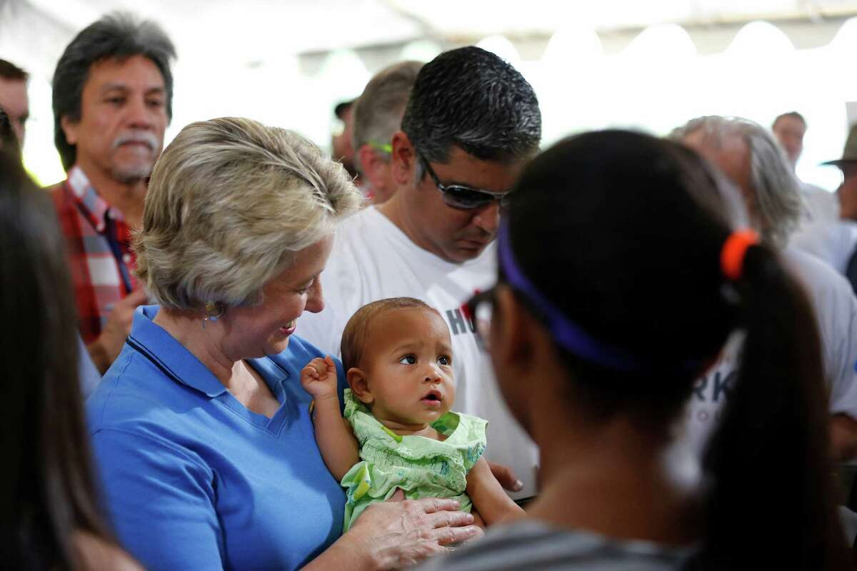 """Houston mayor, Annise Parker, holds """"campaign baby"""", Alejandra Daniels, Saturday, May 11, 2013 during a rally to officially announce her run for a third mayoral term, at Stude park in Houston, Texas. (TODD SPOTH FOR THE CHRONICLE)"""