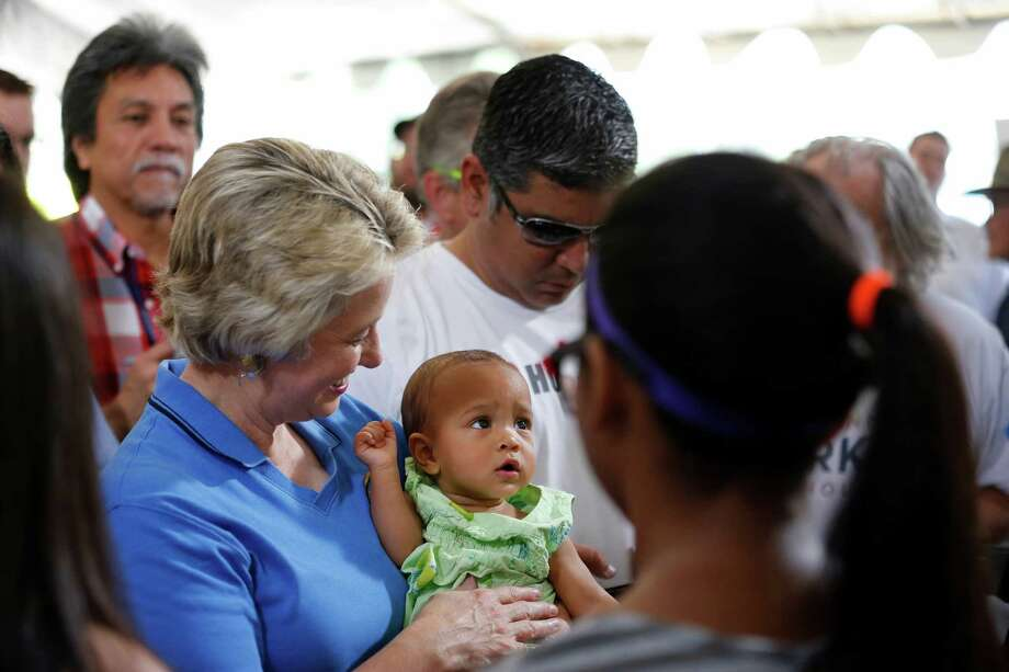 """Houston mayor, Annise Parker, holds """"campaign baby"""", Alejandra Daniels, Saturday, May 11, 2013 during a rally to officially announce her run for a third mayoral term, at Stude park in Houston, Texas. (TODD SPOTH FOR THE CHRONICLE) Photo: © TODD SPOTH, 2013 / © TODD SPOTH, 2013"""