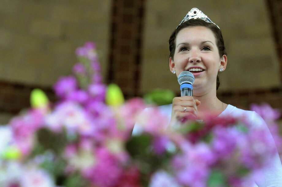 Tulip Queen Kate Bender, 18, of Slingerlands addresses her subjects during the Tulip Festival on Saturday, May 11, 2013, at Washington Park in Albany, N.Y. (Cindy Schultz / Times Union) Photo: Cindy Schultz / 00022344A