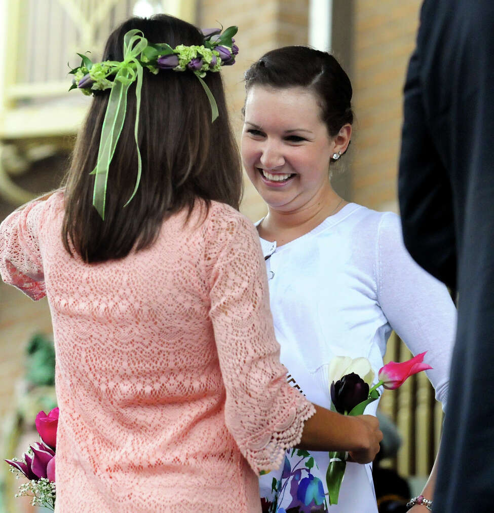 Kate Bender, 18, of Slingerlands is crowned Tulip Queen by outgoing Queen Emily Finnegan at the coronation during the Tulip Festival on Saturday, May 11, 2013, at Washington Park in Albany, N.Y. (Cindy Schultz / Times Union)