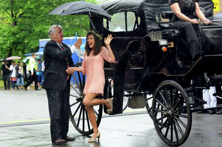 Mayor Jerry Jennings, left, assists outgoing Tulip Queen Emily Finnegan as they arrive at the coronation during the Tulip Festival on Saturday, May 11, 2013, at Washington Park in Albany, N.Y. (Cindy Schultz / Times Union) Photo: Cindy Schultz / 00022344A