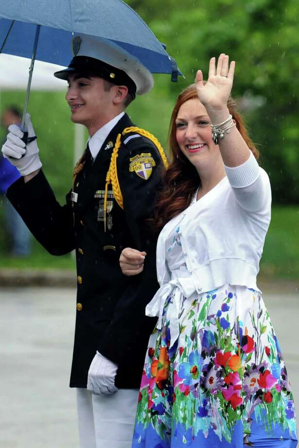 Tulip Queen finalist Meghan Cahill, 19, of Albany waves to the audience as she arrive at the coronation during the Tulip Festival on Saturday, May 11, 2013, at Washington Park in Albany, N.Y. (Cindy Schultz / Times Union) Photo: Cindy Schultz / 00022344A