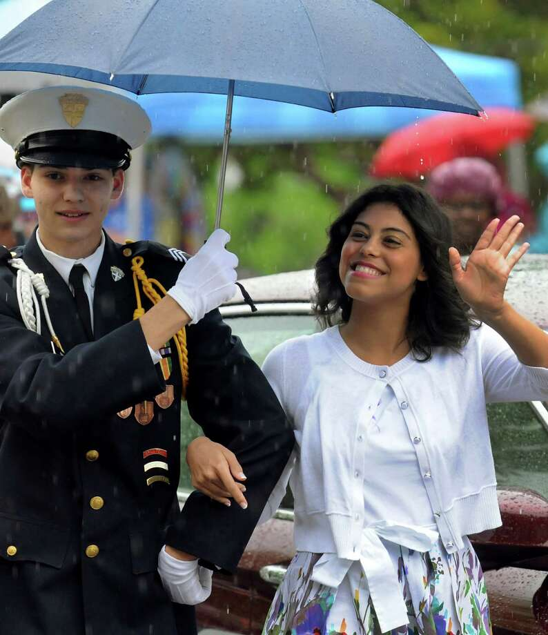 Tulip Queen finalist Fendi Munoz, 21, of Albany waves to the audience as she arrive at the coronation during the Tulip Festival on Saturday, May 11, 2013, at Washington Park in Albany, N.Y. (Cindy Schultz / Times Union) Photo: Cindy Schultz / 00022344A