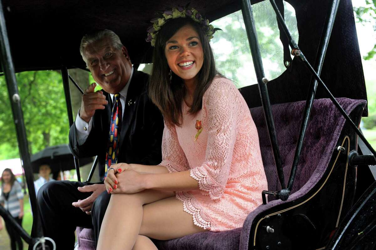Outgoing Tulip Queen Emily Finnegan, right, rides in a carriage with Mayor Jerry Jennings as they parade toward the coronation during the Tulip Festival on Saturday, May 11, 2013, at Washington Park in Albany, N.Y. (Cindy Schultz / Times Union)
