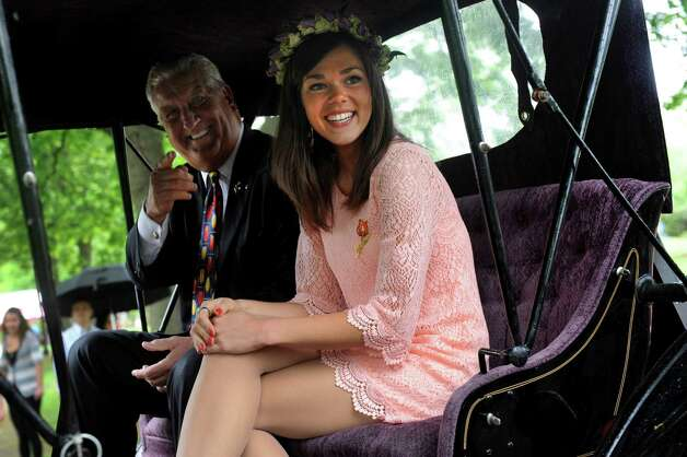 Outgoing Tulip Queen Emily Finnegan, right, rides in a carriage with Mayor Jerry Jennings as they parade toward the coronation during the Tulip Festival on Saturday, May 11, 2013, at Washington Park in Albany, N.Y. (Cindy Schultz / Times Union) Photo: Cindy Schultz / 00022344A