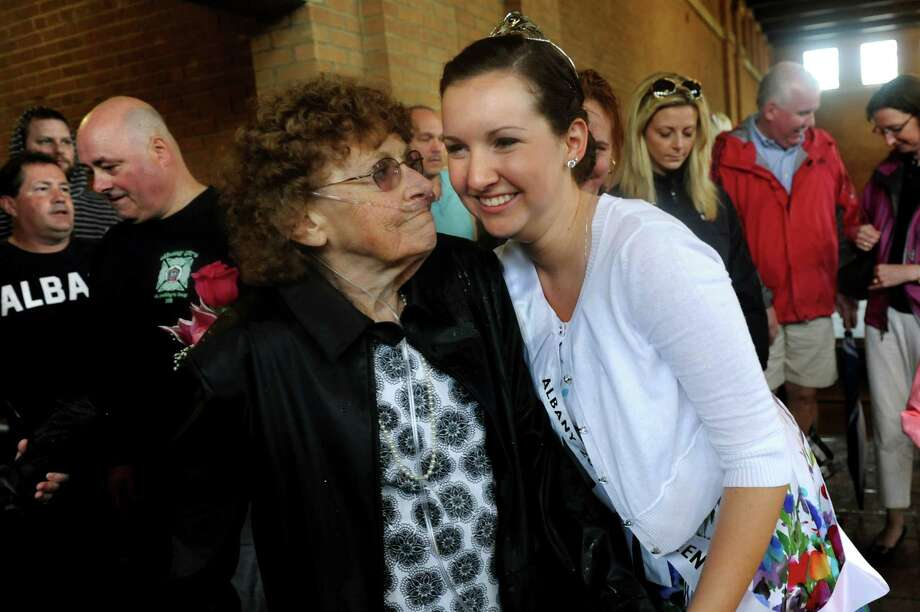 Tulip Queen Kate Bender, 18, of Slingerlands, right, with her grandmother Joline Bender following the coronation during the Tulip Festival on Saturday, May 11, 2013, at Washington Park in Albany, N.Y. (Cindy Schultz / Times Union) Photo: Cindy Schultz / 00022344A
