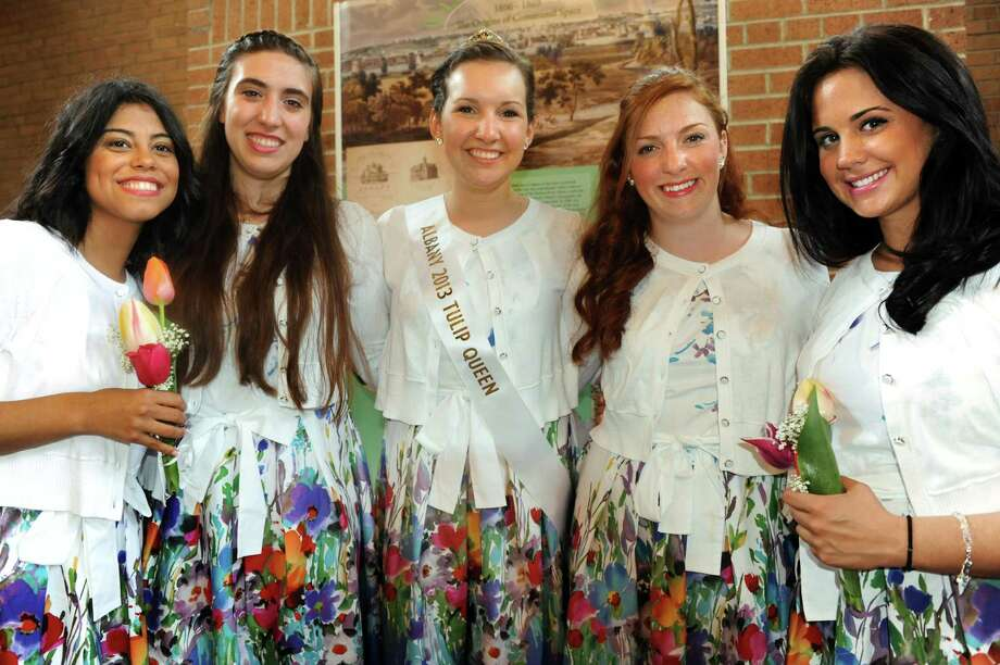Tulip Queen Kate Bender, 18, right, with her court following the coronation during the Tulip Festival on Saturday, May 11, 2013, at Washington Park in Albany, N.Y. From left are Fendi Munoz, 21, Gigi Diffenback, 21, Bender, Meghan Cahill, 19, and Alexis Osborne, 22. (Cindy Schultz / Times Union) Photo: Cindy Schultz / 00022344A