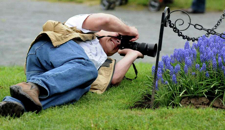 Ralph Rio of Slingerlands gets a fresh perspective of the flowers during the Tulip Festival on Saturday, May 11, 2013, at Washington Park in Albany, N.Y. (Cindy Schultz / Times Union) Photo: Cindy Schultz / 00022344A
