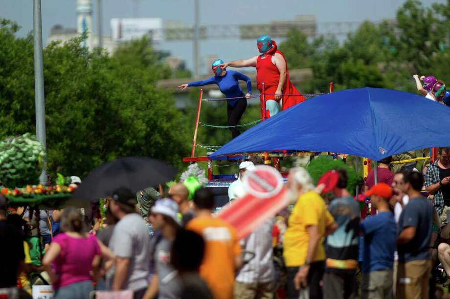 Todd Bowers' Luchamobile art car joined a group of about 300 artful vehicles of all shapes and sizes down Allen Parkway during the 26th annual Houston Art Car Parade May 11, 2013, in Houston. 