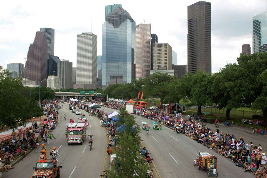 About 300 art cars of all shapes and sizes make their way down Allen Parkway during the 26th annual Houston Art Car Parade May 11, 2013, in Houston. 