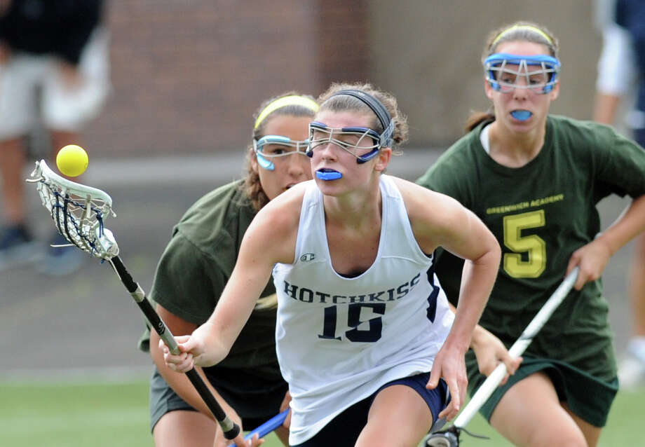 At center, Cait Callahan (# 15) of Hotchkiss goes for the ball while being pursued by Greenwich Academy's Gabby Noto, left, and Annie DeFrino, right, during the girls high school lacrosse match between Greenwich Academy and Hotchkiss School at Greenwich Academy, Saturday, May 11, 2013. Photo: Bob Luckey / Greenwich Time