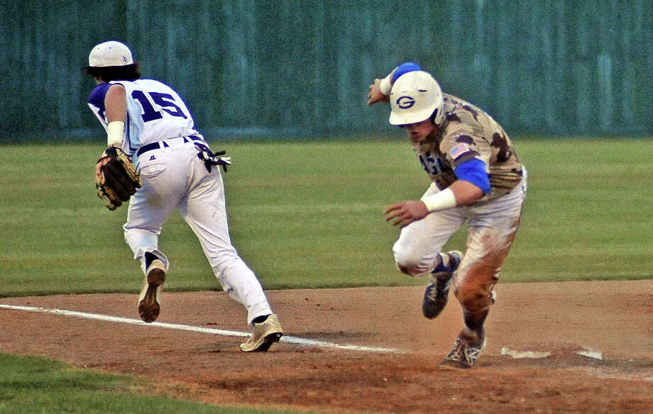 PN-G third baseman Mason Vizena, #15, chases after a passed ball while a Georgetown runner storms home for the tenth run during the Port Neches-Groves district baseball game against Georgetown in Porter on Friday, May 10, 2013.  PN-G lost to Georgetown 10 -2. Photo taken: Randy Edwards/The Enterprise Photo: Randy Edwards