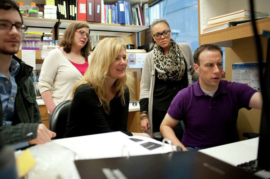 Dr. Kjersti Aagaard, center, leads a team of 12 researchers and scientists at her lab at the Baylor College of Medicine's  obstetrics and gynecology department in Houston. Photo: Spike Johnson, Freelance / Houston Chronicle
