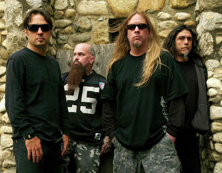 This 2009 publicity photo provided courtesy of Slayer shows, from left, Dave Lombardo, Kerry King, Jeff Hanneman and Tom Araya. Hanneman, 49, died May 2, 2013, of liver failure at a Los Angeles hospital with his wife, Kathy, by his side. It was initially theorized that Hanneman's death might have had something to do with a suspected spider bite that led to a case of necrotizing fasciitis, nearly costing him his arm. Members of Slayer say Hanneman died of alcohol-related cirrhosis. (AP Photo/Courtesy of Slayer, Mark Seliger) Photo: Mark Seliger