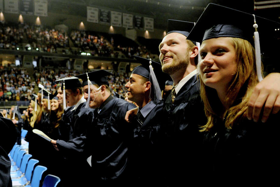 Smiles on graduation day could turn into tomorrow's frowns. The average student in the 2013 graduating class will have about $24,000 in debt loans, an increase of 30 percent since 2007. Photo: Abby Drey, Associated Press / Centre Daily Times
