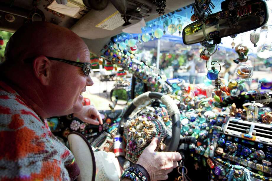 Randy Blair drives his art car, Little Bit of Nonsense, to join about 300 art cars of all shapes and sizes along Allen Parkway before the 26th annual Houston Art Car Parade May 11, 2013, in Houston. Photo: Johnny Hanson, Houston Chronicle / © 2013  Houston Chronicle