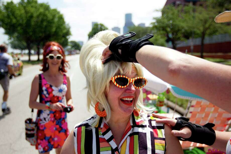 Marlene Iacouiello had her hair adjusted by Anya Keez before the start of the 26th annual Houston Art Car Parade May 11, 2013, in Houston.  The parade, produced by the Orange Show is the largest art car parade in the world. Photo: Johnny Hanson, Houston Chronicle / © 2013  Houston Chronicle